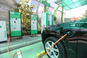 An electric car being charged at PTT's electric vehicle charging station, which opened earlier this month on Chaiyaphruek Road, Nonthaburi. KITJA APICHONROJAREK