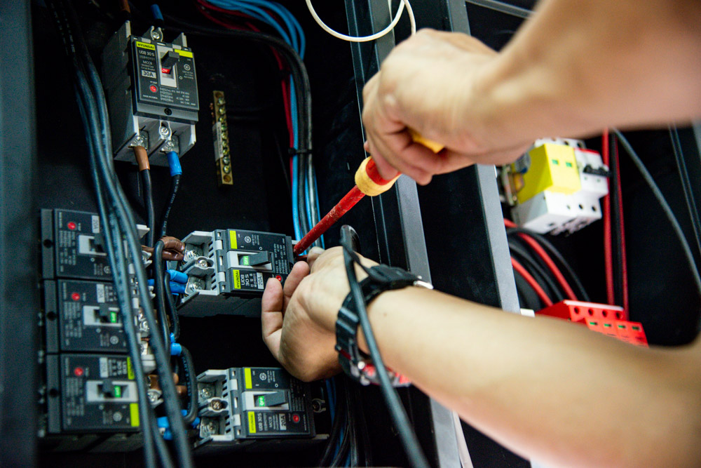 Close up of electrical technician working