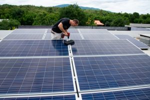 Solar Panels Being Installed on a roof in Chiang Mai Thailand